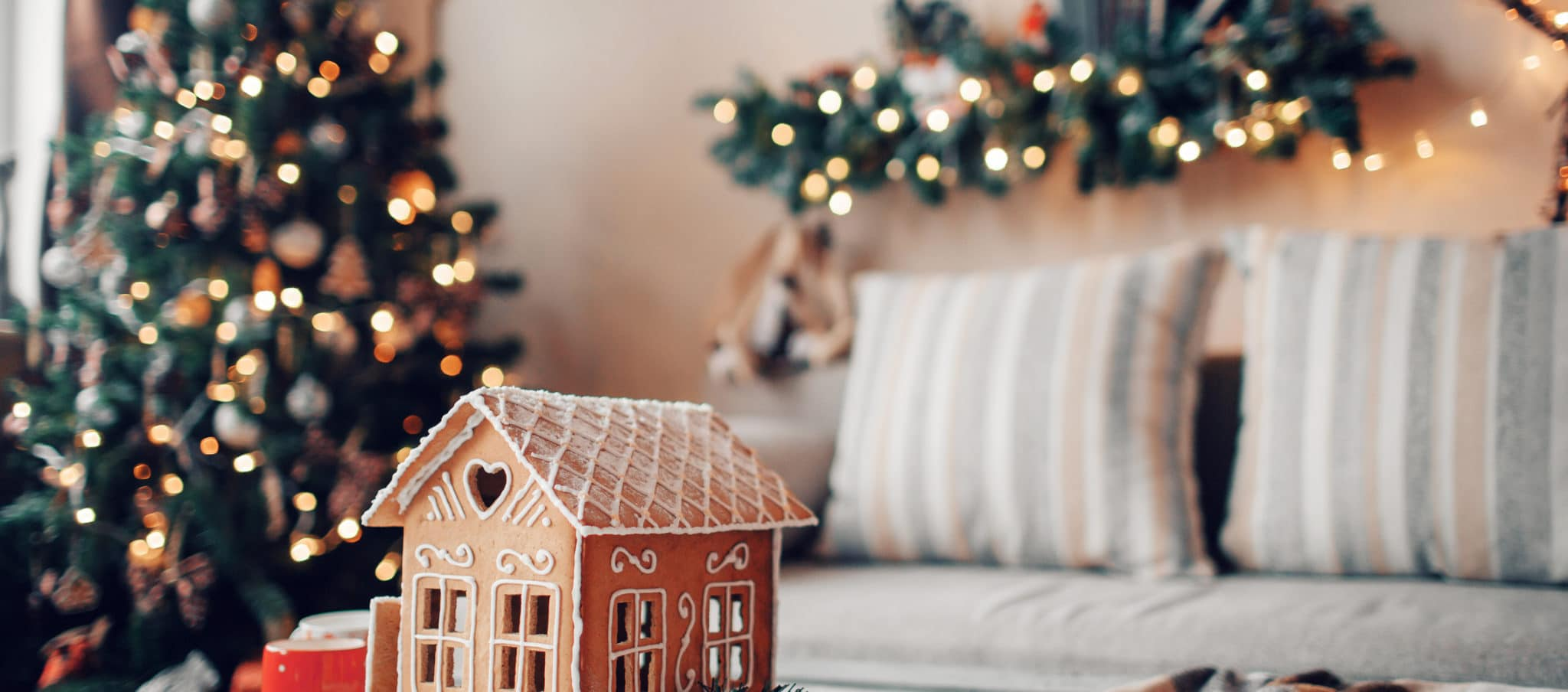 Homemade gingerbread house on light room background