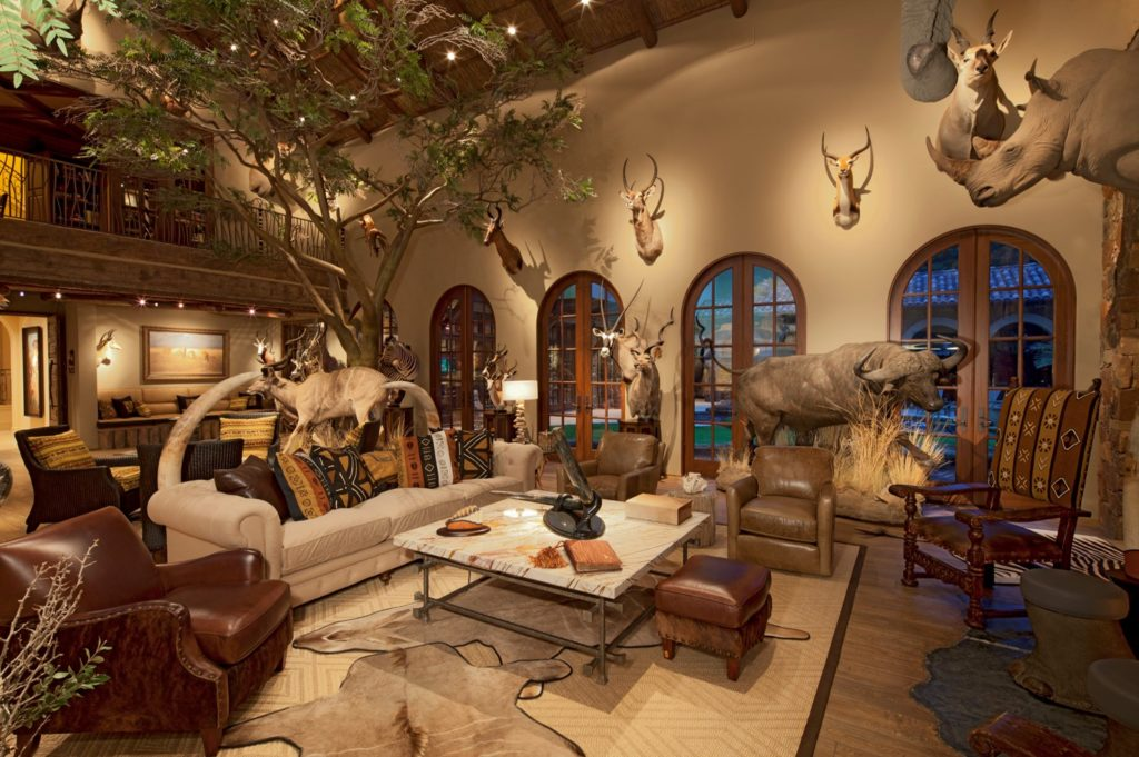 Large room with vaulted ceiling and animal heads on the wall.