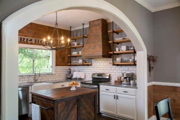 Kitchen with beautiful custom wood shelves.