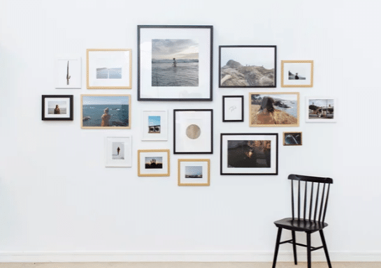 Picture frames hanging on a white wall.