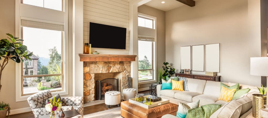 Beautiful living room with hardwood floors, tv, and fireplace